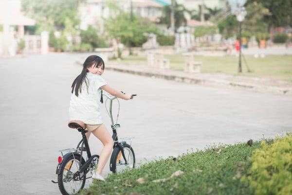 Beautiful asian girl riding a bike
