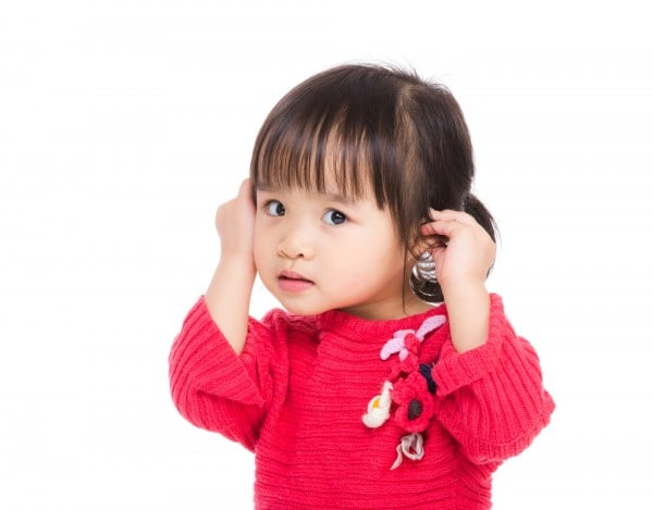 Asia little girl touch her ear
