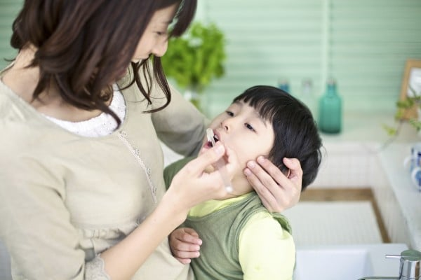 Japanese Mother and Son Brushing Teeth