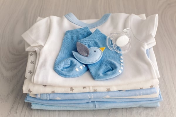 children's clothes with the diapers are stacked