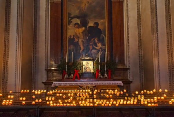 Icon and candles in cathedral at Salzburg Austria